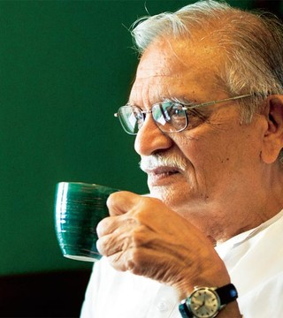 A man with several wings on his hat: Gulzar Sahab
